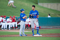 Ogden Raptors third baseman Marcus Chiu (13) talks to manager Jeremy Rodriguez (7) during a Pioneer League game against the Orem Owlz at Home of the OWLZ on August 24, 2018 in Orem, Utah. The Ogden Raptors defeated the Orem Owlz by a score of 13-5. (Zachary Lucy/Four Seam Images)