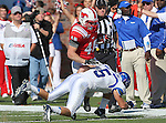 Memphis Tigers defensive back CANNON SMITH (5) tackles Southern Methodist Mustangs running back ZACH LINE (48) during the game between the Memphis Tigers and the Southern Methodist Mustangs at the Gerald J. Ford Stadium in Dallas, Texas. Memphis defeats SMU 48 to 3...
