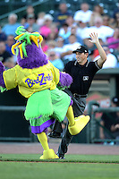 Mascot BirdZerk! dances with an actor portraying an umpire during a game against the Great Lakes Loons at Dow Stadium on July 22, 2011 in Midland, Michigan.  Great Lakes defeated Beloit 5-2.  (Mike Janes/Four Seam Images)
