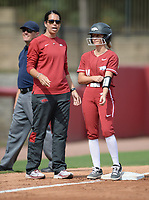 Arkansas coach Courtney Deifel speaks Saturday, Oct. 9, 2021, with a pinch runner during play against Butler Community College at Bogle Park in Fayetteville. Visit nwaonline.com/211010Daily/ for today's photo gallery.<br /> (NWA Democrat-Gazette/Andy Shupe)