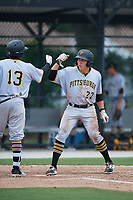 GCL Pirates Mason Martin (22) is congratulated by Felix Vinicio (13) after hitting a home run during a game against the GCL Blue Jays on July 20, 2017 at Bobby Mattick Training Center at Englebert Complex in Dunedin, Florida.  GCL Pirates defeated the GCL Blue Jays 11-6 in eleven innings.  (Mike Janes/Four Seam Images)