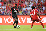 AC Milan Forward MBaye Niang (L) plays against Bayern Munich Defender David Alaba (R) during the 2017 International Champions Cup China match between FC Bayern and AC Milan at Universiade Sports Centre Stadium on July 22, 2017 in Shenzhen, China. Photo by Marcio Rodrigo Machado/Power Sport Images