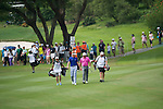 The crowd follows Graeme McDowell of Northern Ireland (pink shirt) and Ian Poulter of England (blue shirt) during Hong Kong Open golf tournament at the Fanling golf course on 25 October 2015 in Hong Kong, China. Photo by Aitor Alcade / Power Sport Images