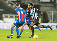 2nd February 2021; St James Park, Newcastle, Tyne and Wear, England; English Premier League Football, Newcastle United versus Crystal Palace; Allan Saint-Maximin of Newcastle United  under pressure from Scott Dann and and Jean-Philippe Mateta of Crystal Palace