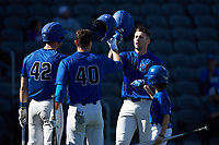 Chris Crabtree (3) of the Duke Blue Devils is greeted at home plate by teammates RJ Schreck (40) and Erikson Nichols (42) after hitting a home run against the Coastal Carolina Chanticleers at Segra Stadium on November 2, 2019 in Fayetteville, North Carolina. (Brian Westerholt/Four Seam Images)