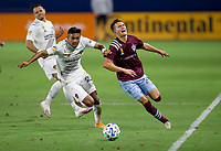 CARSON, CA - SEPTEMBER 19: Julian Araujo #22 of the Los Angeles Galaxy and Cole Bassett #26 of the Colorado Rapids battle for a ball along the sideline during a game between Colorado Rapids and Los Angeles Galaxy at Dignity Heath Sports Park on September 19, 2020 in Carson, California.