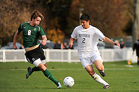 Gabe Hoffman-Johnson (8) of the Dartmouth Big Green and Christian Nogueira (2) of the Monmouth Hawks battle for the ball. Dartmouth defeated Monmouth 4-0 during the first round of the 2010 NCAA Division 1 Men's Soccer Championship on the Great Lawn of Monmouth University in West Long Branch, NJ, on November 18, 2010.