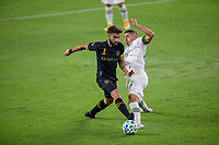 LOS ANGELES, CA - SEPTEMBER 13: Diego Rossi #9 of LAFC and Portland Timber's Marvin Loria #44 reach for the ball during a game between Portland Timbers and Los Angeles FC at Banc of California stadium on September 13, 2020 in Los Angeles, California.