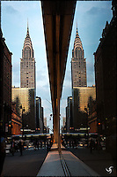 Chrysler Building with it's reflection in a big window.