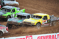 Mar. 19, 2011; Chandler, AZ, USA;  LOORRS pro two driver Rob Naughton 54 gets nudged to the outside by Jeremy McGrath in turn 3 during round one at Firebird International Raceway. Mandatory Credit: Mark J. Rebilas-US PRESSWIRE