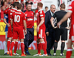 Mark Warburton confronts referee John Beaton on the pitch at full-time