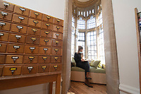 BNPS.co.uk (01202) 558833<br /> Pic: ZacharyCulpin/BNPS<br /> <br /> PICTURED: Collections assistant, Kat Broomfield pictured in the stunning newly refurbished library<br /> <br /> An important Roman mosaic that has been saved for the nation went on display today at a county museum.<br /> <br /> The Dorset Museum unveiled the 1,700-year-old panel depicting a leopard attacking an antelope that it acquired earlier this year to stop it from going abroad.<br /> <br /> It forms the centrepiece for the venue which is about to reopen following a £16m transformation that has taken three years.