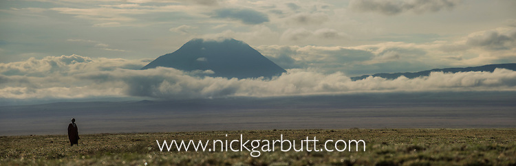 Oldonyo Lengai, open plains and Maasai. Area above Lake Natron, Ngorongoro Conservation Area, Tanzania.