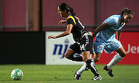 LA defender Stephanie Cox (14) takes the ball away from Sky Blue defender Keeley Dowling (17).   Sky Blue played to a 0-0 tie against the LA Sol Saturday, June 13, in Piscataway, NJ.