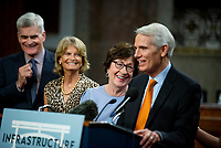 United States Senator Bill Cassidy (Republican of Louisiana), left, United States Senator Lisa Murkowski (Republican of Alaska), second from left, and United States Senator Susan Collins (Republican of Maine), second from right, share in a laugh while United States Senator Rob Portman (Republican of Ohio), right, makes remarks after the vote on the motion to invoke cloture to proceed to the consideration of H.R. 3684, the INVEST in America Act on Capitol Hill in Washington, DC on Wednesday, July 28, 2021. The vote to begin discussion of the bipartisan infrastructure bill agreed to by the White House, was 67 to 32. If passed, the bill would invest close to $1 trillion in roads, bridges, ports and other infrastructure without a major tax increase.<br /> Credit: Rod Lamkey / CNP / MediaPunch