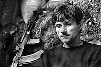 Bosnian government soldier Jasmin Hatibovic? sits in a frontline position on the perimeter of the besieged capital Sarajevo on May 23, 1993.