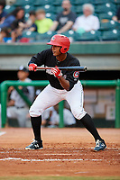 Chattanooga Lookouts right fielder Edgar Corcino (21) squares around to bunt during a game against the Jackson Generals on May 9, 2018 at AT&T Field in Chattanooga, Tennessee.  Chattanooga defeated Jackson 4-2.  (Mike Janes/Four Seam Images)