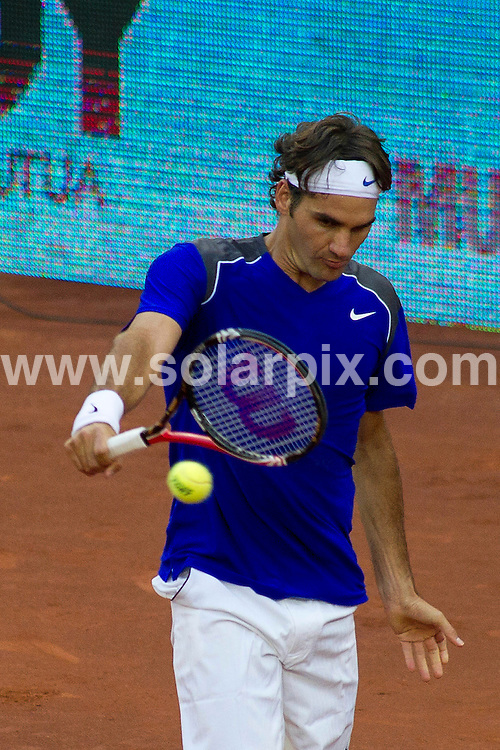 **ALL ROUND PICTURES FROM SOLARPIX.COM**                                             **WORLDWIDE SYNDICATION RIGHTS EXCEPT SPAIN - NO SYNDICATION IN SPAIN**                                                                                  Caption: Roger Federer plays in the Madrid Open tennis tournament. Madrid, Spain. 3 May 2011                                                                              This pic: Roger Federer                                                                                       JOB REF: 13267 DMS Drake      DATE: 03_05_2011                                                           **MUST CREDIT SOLARPIX.COM OR DOUBLE FEE WILL BE CHARGED**                                                                      **MUST AGREE FEE BEFORE ONLINE USAGE**                               **CALL US ON: +34 952 811 768 or LOW RATE FROM UK 0844 617 7637**