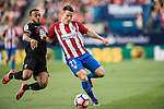 Kevin Gameiro of Atletico de Madrid competes for the ball with Ruben Miguel Nunes Vezo of Granada CF during their La Liga match between Atletico de Madrid and Granada CF at the Vicente Calderon Stadium on 15 October 2016 in Madrid, Spain. Photo by Diego Gonzalez Souto / Power Sport Images
