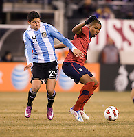 Juan Agudelo (9) of the United States fights for the ball with Marcos Rojo (24) of Argentina during an international friendly at New Meadowlands Stadium in East Rutherford, NJ.  The United States tied Argentina, 1-1.