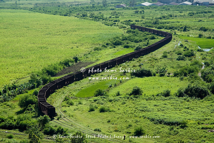 Long line of train wagons which were used for transportation on the former sugar cane plantation Manaca-Iznaga, Cuba.