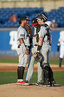 Fayetteville Woodpeckers shortstop Jonathan Arauz (left) helps translate for catcher Michael Papierski (28) as he talks to starting pitcher Jojanse Torres (39) during the game against the Wilmington Blue Rocks at Frawley Stadium on June 6, 2019 in Wilmington, Delaware. The Woodpeckers defeated the Blue Rocks 8-1. (Brian Westerholt/Four Seam Images)