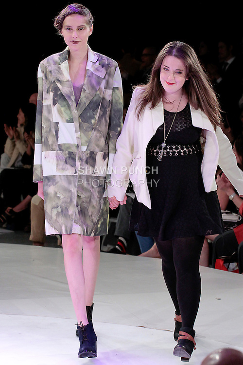 Graduating fashion student Rachel Duncan, walks runway with model at the close of the 2013 Pratt Institute Fashion Show, on April 25, 2013.