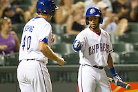 Round Rock Express shortstop Leury Garcia (6) greets teammate Jared Hoying (40) after he scored in the Pacific Coast League baseball game against the New Orleans Zephyrs on June 30, 2013 at the Dell Diamond in Round Rock, Texas. Round Rock defeated New Orleans 5-1. (Andrew Woolley/Four Seam Images)