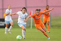 Karen Carney (14) of the Chicago Red Stars is marked by Heather O'Reilly (9) of Sky Blue FC. The Chicago Red Stars defeated Sky Blue FC 2-1 during a Women's Professional Soccer (WPS) match at Yurcak Field in Piscataway, NJ, on August 01, 2010.