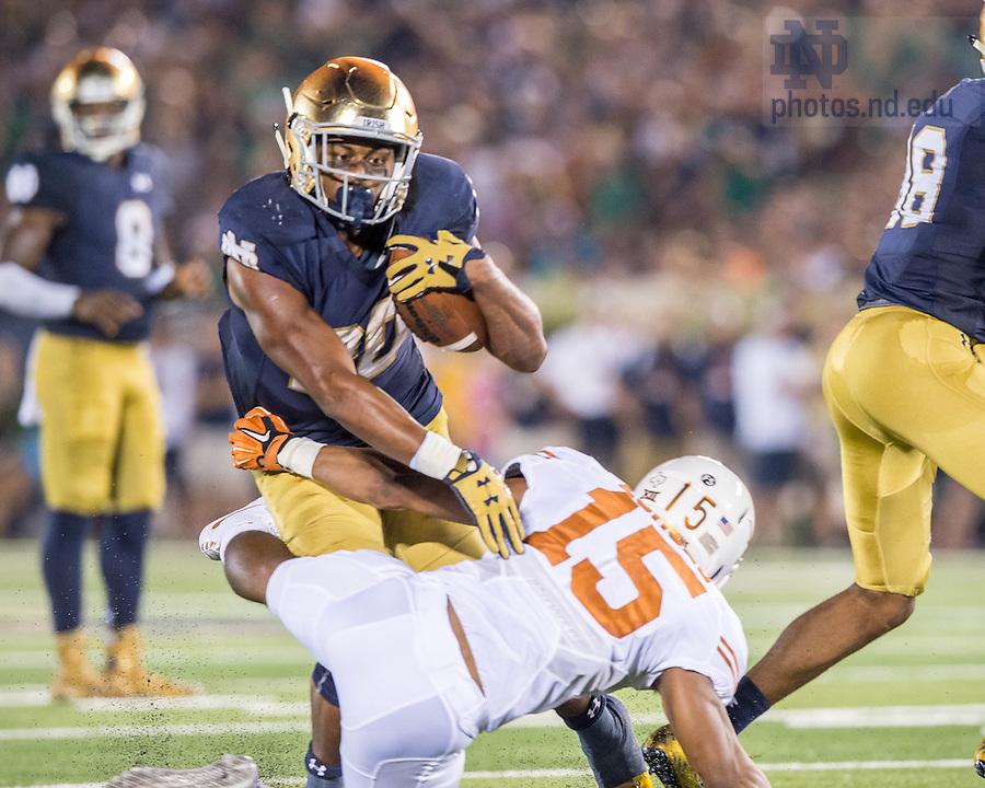 Sep 5, 2015; Irish running back C.J. Prosise (20) runs the ball against Texas. Notre Dame won 38-3. (Photo by Matt Cashore)