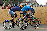17 AUG 2014 - LONDON, GBR - Players from Sentinels (in light blue) and Jackie Chan is Dead (dark blue) attempt to gain control of the ball at the 2014 London Open Bike Polo tournament in Highbury Fields in London, Great Britain (PHOTO COPYRIGHT © 2014 NIGEL FARROW, ALL RIGHTS RESERVED)