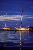 Yachts 'Heron' and 'Mahina Tiare' , Halberg-Rassy 46's, anchored at sunset off Moorea, Society Islands, French Polynesia