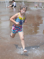 Braylee Miller, 5, runs through a jet of water Thursday June 10, 2021 at the Fountains at Lawrence Plaza splash pad in Bentonville. Braylee was at the park with her mom Bridgit Miller ((CQ)) of Bentonville and her little sister Layna Miller, 2.((CQ)) The park is open daily from 9 a.m. – 10 p.m. Visit nwaonline.com/2100611Daily/ and nwadg.com/photo. (NWA Democrat-Gazette/J.T. Wampler)