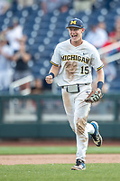 Michigan Wolverines first baseman Jimmy Kerr (15) celebrates following Game 11 of the NCAA College World Series against the Texas Tech Red Raiders on June 21, 2019 at TD Ameritrade Park in Omaha, Nebraska. Michigan defeated Texas Tech 15-3 and is headed to the CWS Finals. (Andrew Woolley/Four Seam Images)