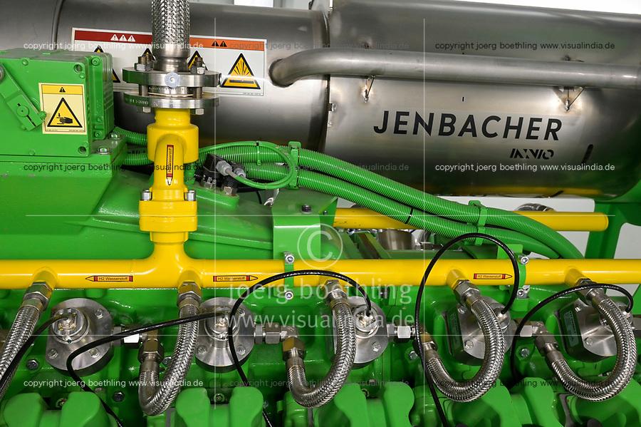 GERMANY, Hamburg, Cogeneration unit for heating and power supply with natural gas or green hydrogen, Jenbacher gas engine / DEUTSCHLAND, Hamburg, Hansewerk Natur, BHKW Blockheizkraftwerk 1 MW Klasse, das über Kraft-Wärme-Kopplung eine Siedlung mit Strom und Wärme versorgt, Energiequellen Erdgas oder grüner Wasserstoff gewonnen aus erneuerbarer Energie, Jenbacher Gasmotor, der wahlweise grünen Wasserstoff oder Erdgas verbrennen kann