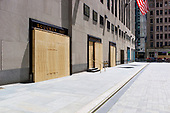 New York New York<br /> June 7, 2020<br /> <br /> After several nights of looting, nearly all ground level windows around Rockefeller Center are covered with plywood. Many of the shops had already been looted others are boarded for protection.