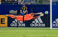 CARSON, CA - OCTOBER 18: Jonathan Klinsmann #33 GK of Los Angeles Galaxy makes a diving save during a game between Vancouver Whitecaps and Los Angeles Galaxy at Dignity Heath Sports Park on October 18, 2020 in Carson, California.