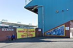A Kilmarnock fan waiting at the disabled fans entrance in the Frank Beattie stand at Rugby park. Kilmarnock 2 Ayr United 0, Scottish Championship, August 2nd 2021. Following Kilmarnock's relegation in 2020-21, the first game of the new season is the Ayreshire Derby, the first league match between the teams in 28 years. Due to relaxation of Covid restrictions the match was played in front of a crowd of 3200 Kilmarnock fans. The game was shown live on BBC Scotland.