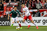 Harrison, NJ - Tuesday April 10, 2018: Carlos Cisneros, Florian Valot during leg two of a  CONCACAF Champions League semi-final match between the New York Red Bulls and C. D. Guadalajara at Red Bull Arena. C. D. Guadalajara defeated the New York Red Bulls 0-0 (1-0 on aggregate).