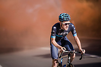 Joonas Henttala (FIN/Novo Nordisk) making his way through the smoke up the Capo Berta<br /> <br /> thik smoke once again covers the Capo Berta passage of the riders > but this time year the bushes catch fire (!! 🔥) and flair up just as the riders ride by<br /> <br /> 110th Milano-Sanremo 2019 (ITA)<br /> One day race from Milano to Sanremo (291km)<br /> <br /> ©kramon