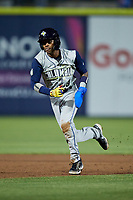 Maikel Garcia (8) of the Columbia Fireflies takes off for third base against the Kannapolis Cannon Ballers at Atrium Health Ballpark on May 18, 2021 in Kannapolis, North Carolina. (Brian Westerholt/Four Seam Images)