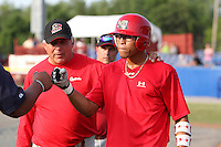 Batavia Muckdogs outfielder Reggie Williams during batting practice with hitting coach Roger LaFrancois #17 during the teams pre-season pep rally at Dwyer Stadium on June 15, 2011 in Batavia, New York.  Photo By Mike Janes/Four Seam Images