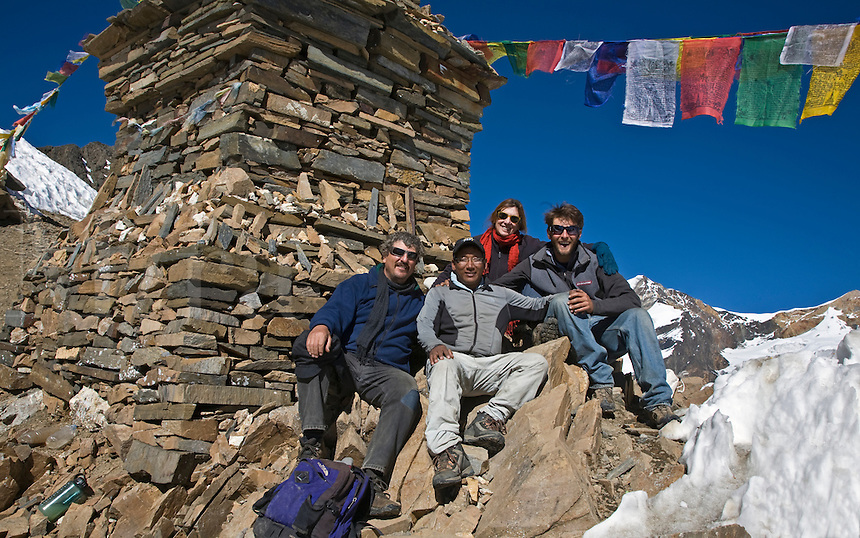 TREKKERS rest atop the KANG LA PASS at 5306 meters on the NAR PHU TREK - ANNAPURNA CONSERVATION AREA, NEPAL (MR)