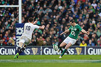 Jonathan Sexton of Ireland kicks upfield past his opposite number Owen Farrell of England during the RBS 6 Nations match between Ireland and England at the Aviva Stadium, Dublin on Sunday 10 February 2013 (Photo by Rob Munro)