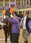 Court Vision, ridden by jockey Robby Albarado and trained by Dale Romans win the Breeders' Cup Mile at Churchill Downs on  November 4, 2011..