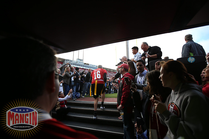 SAN FRANCISCO, CA - JULY 12:  Former San Francisco 49ers quarterback Joe Montana enters the field before the Legends of Candlestick flag football game at Candlestick Park in San Francisco, California on July 12, 2014. Photo by Brad Mangin