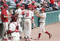 Arkansas infielder Robert Moore (1) returns to the dugout, Saturday, April 3, 2021 during the third inning of a baseball game at Baum-Walker Stadium in Fayetteville. Check out nwaonline.com/210404Daily/ for today's photo gallery. <br /> (NWA Democrat-Gazette/Charlie Kaijo)