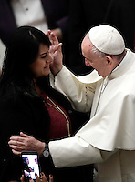 Papa Francesco saluta una fedele al termine dell'Udienza Generale del mercoledi' in aula Paolo VI in Vaticano, 28 dicembre 2016.<br /> Pope Frances greets a woman at the end of his weekly general audience in Paul VI Hall at the Vatican on December 28, 2016.<br /> UPDATE IMAGES PRESS/Isabella Bonotto<br /> <br /> STRICTLY ONLY FOR EDITORIAL USE