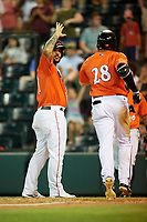 Richmond Flying Squirrels first baseman K.C. Hobson (17) waits to congratulate Dillon Dobson (28) on his eighth inning home run during a game against the Trenton Thunder on May 11, 2018 at The Diamond in Richmond, Virginia.  Richmond defeated Trenton 6-1.  (Mike Janes/Four Seam Images)