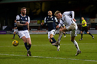 29th December 2020; Dens Park, Dundee, Scotland; Scottish Championship Football, Dundee FC versus Alloa Athletic; Cameron O'Donnell of Alloa Athletic clears from Christie Elliott of Dundee